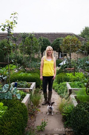 Bunny Guinness - Broadcaster, author and garden designer, with her dog
