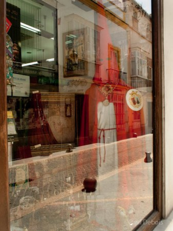 Religious shop, El Puerto de Santa Maria, Spain, with robes worn by Los Penitentes or penitents during Holy Week