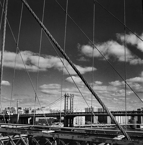 View of Manhattan Bridge from Brooklyn Bridge in New York