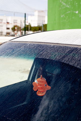 Conil, car with fish mirror mascot