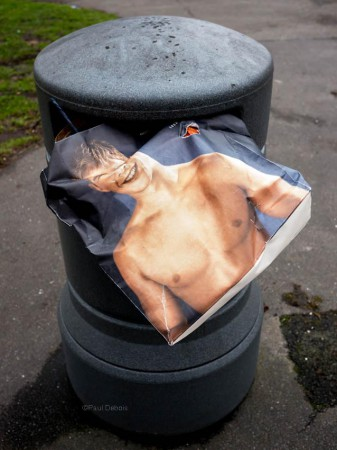 Carrier bag in rubbish bin