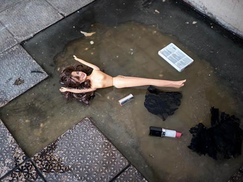 Barbie Doll in puddle, Waterloo Bridge